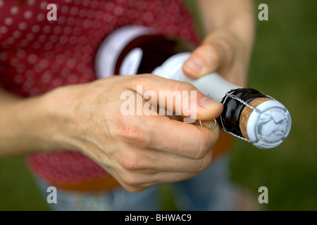 Champagne bottle being opened - Stock Photo