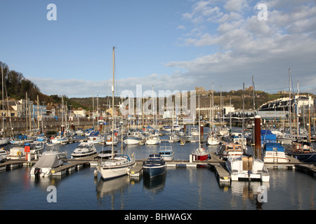 Dover yacht marina with the magnificent Dover castle dominating the hill overlooking the harbour. - Stock Photo