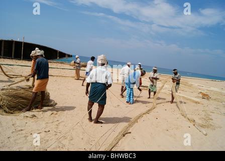 Beautiful view of Fishermen arranging their Fishing Nets in the coastal area of Kerala,India - Stock Photo