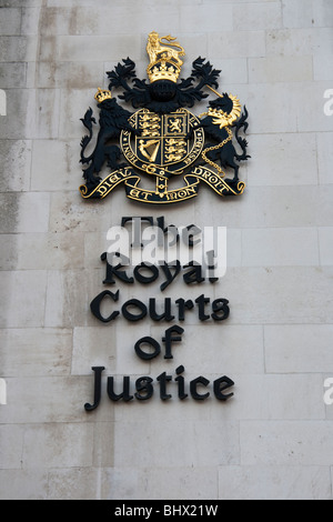 The Royal Courts of Justice coat of arms, home of the Supreme Court.  The Strand, London, England. UK - Stock Photo