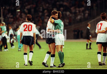 World Cup 1990 Semi Final England 1 West Germany 1 Chris Waddle Football is consoled and embraced by Lothar Matthaus - Stock Photo