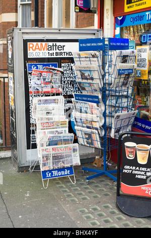 Newsagents shop international papers display, London, England, UK, Europe - Stock Photo