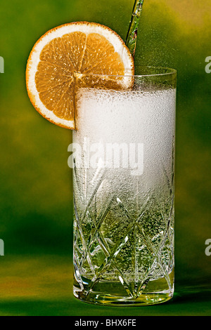 Pouring a gin and tonic - Stock Photo