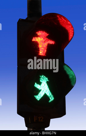 East german traffic light for pedestrians, red and green, in Berlin Mitte, Germany - Stock Photo