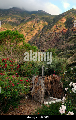 An outdoor garden shower in the backyard of a home, in the village of Pollara, on the Aeolian island of Salina, - Stock Photo
