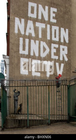 Urban gorilla graffiti artists (Banksey) Mural in central post office car park off Oxford St London - Stock Photo