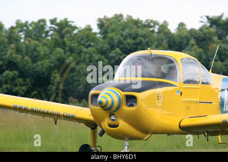 A Fuji FA200 Aero Subaru single engine aerobatic plane gets ready to take off. - Stock Photo