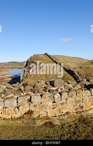 On the line of Hadrian's Wall looking towards Highshield Crags and Crag Lough. - Stock Photo