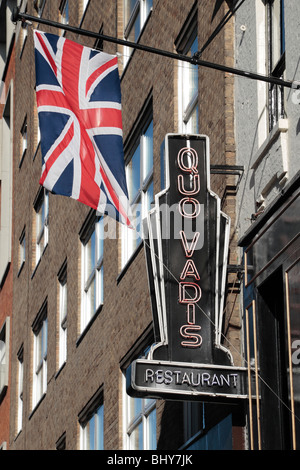 Union flag flying above 'Quo Vadis' restaurant in Soho, London, UK. - Stock Photo