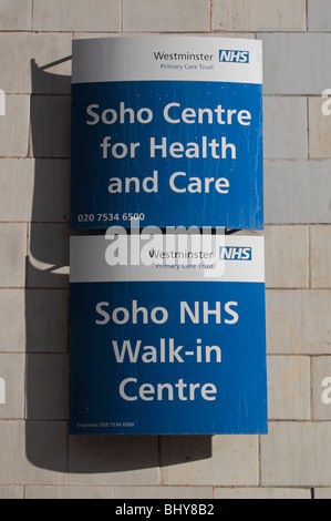 Sign outside the Soho Centre for Health and Care and Soho NHS Walk-in centre, London, UK. - Stock Photo