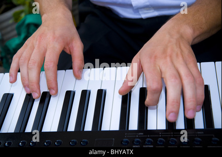 Hands playing piano - Stock Photo