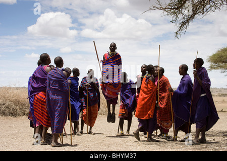 Jumping Dance at a Masai Village, Ngorongoro Conservation Area, Tanzania, East Africa - Stock Photo