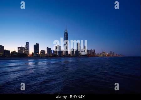 Surfers Paradise, Gold Coast Australia skyline at twilight  (low aerial view from a helicopter) - Stock Photo