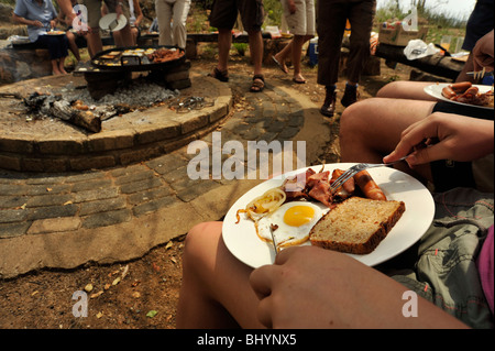 Limpopo, South Africa, close up, food in dish, breakfast meal cooked on outdoor camp fire, holiday, family, socialising, - Stock Photo