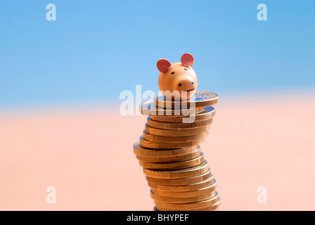 Lucky pig on a Coin Stack - Stock Photo