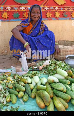 Elderly Cucumber Seller In Puri, Orissa State, India - Stock Photo