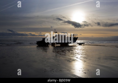 Early dawn Lifeboat Launch by Tractor, Clogher Head, County Louth, Ireland - Stock Photo