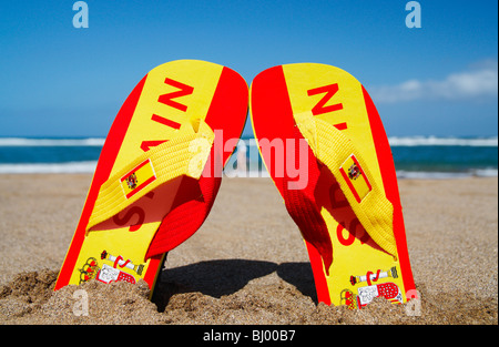 Flip flops in colours of Spanish flag with Spain written embossed on them - Stock Photo