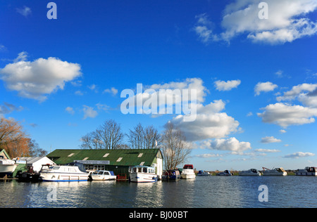A boatyard by a bend in the River Ant downstream of Ludham Bridge, Norfolk, United Kingdom. - Stock Photo