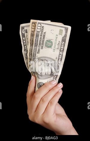 A hand holding money - Stock Photo