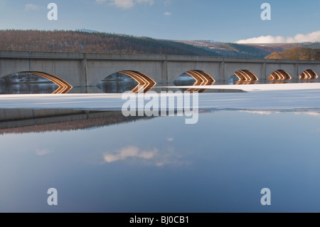 Reflections beneath the viaduct running over Ladybower Reservoir in the Peak District - Stock Photo