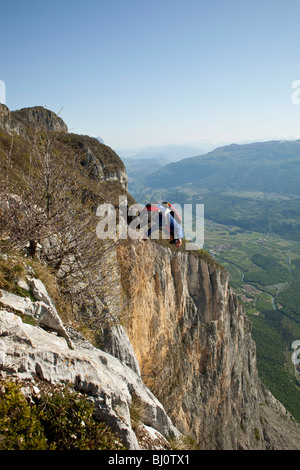 BASE jump from a cliff. The ultimate kick to do an object jump with front flip down into the deep valley. - Stock Photo