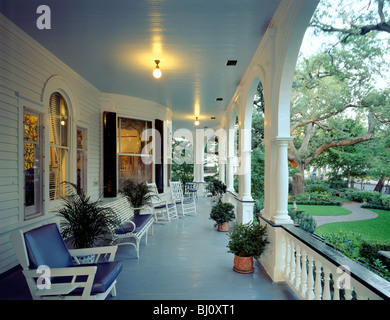 Exterior porch view of Two Meeting Street Inn, c1892, bed & breakfast, a Queen Anne Mansion style home in Charleston, - Stock Photo