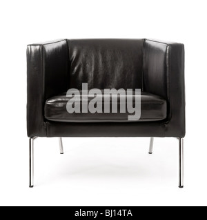 Studio shot of front view of modern black leather and chrome armchair on white background. - Stock Photo