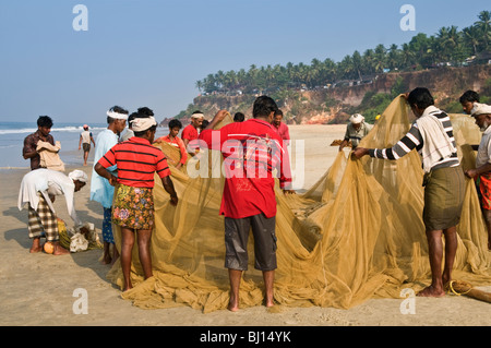 Fishermen on Papanasam Beach Varkala Kerala India - Stock Photo