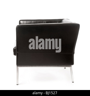 Studio shot of side view of modern black leather and chrome armchair on white background. - Stock Photo