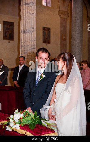 Bride and groom at wedding looking at each other - Stock Photo