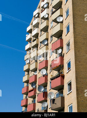 Balconies with dish antennas on a block of flats in Hamburg, Germany - Stock Photo