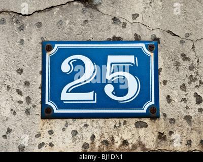 Enameled 25 house number - Indre, France. - Stock Photo