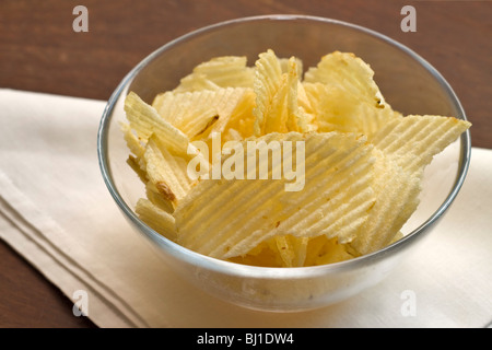 A bowl of potato crisps - Stock Photo
