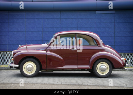 1968 Morris Minor two-door saloon in maroon red - Stock Photo