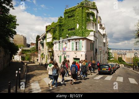 school class crossing road in Montmartre Paris France - Stock Photo