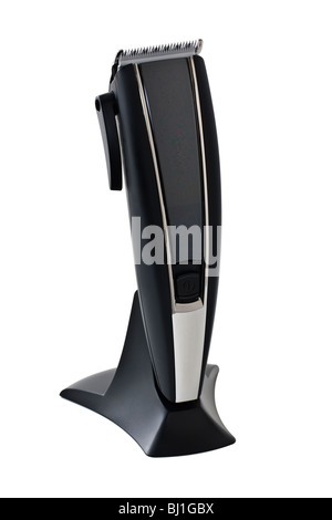 Black ceramic bladed adjustable portable electric hair clippers on a black stand - Stock Photo