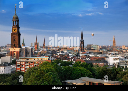Evening view from the tower-lounge in the Hotel Hafen towards the St. Michaelis Churche and Hamburg, Germany. - Stock Photo