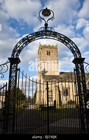 St Mary's Church and wrought iron gateway, Kirkby Lonsdale, Cumbria, UK winter - Stock Photo