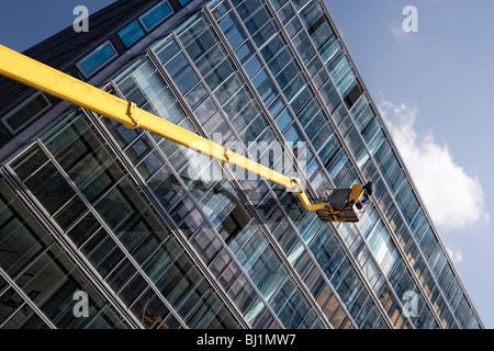 Windowcleaner cleaning a window, Hamburg, Germany, Europe - Stock Photo
