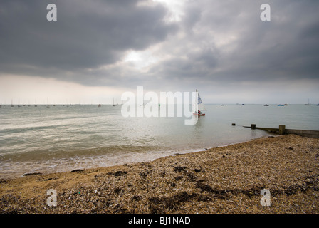 Sailboat heading out to sea - Stock Photo