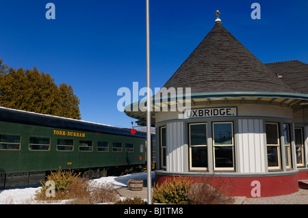 The York Durham Heritage Railway at the Uxbridge Ontario train station in winter with blue sky - Stock Photo