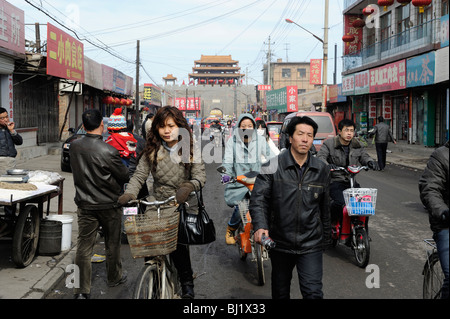 People in the street of Yuxian, Hebei province, a typical town in Western China. 02-Mar-2010 - Stock Photo