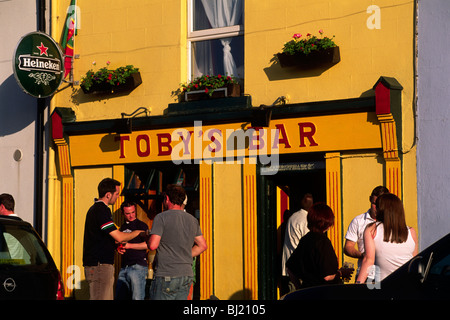 ireland, county mayo, westport, irish people talking in front of toby's bar - Stock Photo