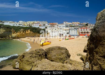 Portugal, The Algarve, Praia Do Carvoeiro Village And Beach In Summer - Stock Photo