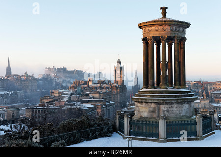 The Dugald Stewart Monument on Calton Hill with view of City skyline including Edinburgh Castle, Scotland, UK. - Stock Photo