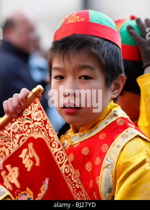 A young performer at the Chinese New Year parade in the streets of Paris, France - Stock Photo