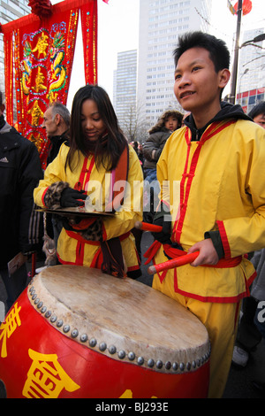Young musicians performing at the Chinese New Year parade in the streets of Paris, France - Stock Photo