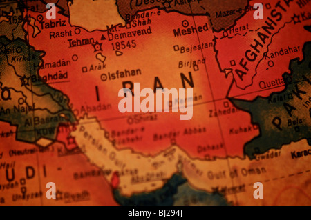 A detail photo of the world as depicted on an antique globe. Focusing on Iran. - Stock Photo
