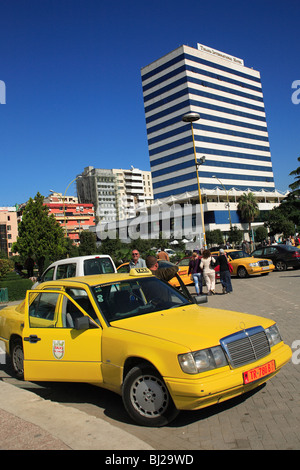Taxi in front of the Tirana International Hotel, Tirana, Albania - Stock Photo